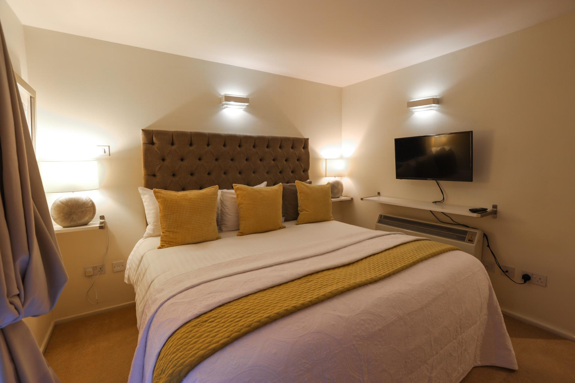 Cosy bedroom at 116 Point West Apartments, South Kensington, London