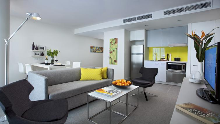 Cosy living area at Citadines Bourke Apartments