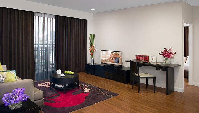 Living area at Somerset Park Suanplu Apartments