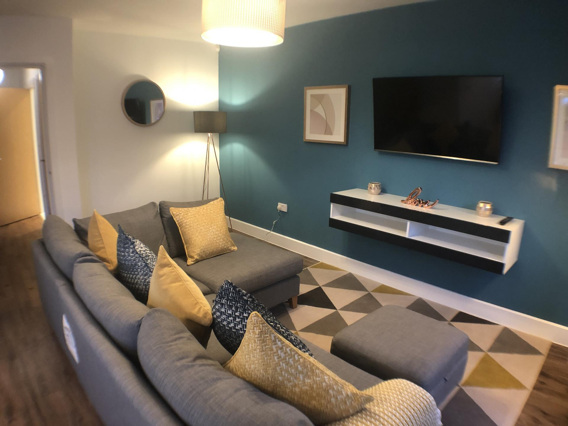 Grey sofa at Mulberry Lodge Apartments, Centre, St Albans