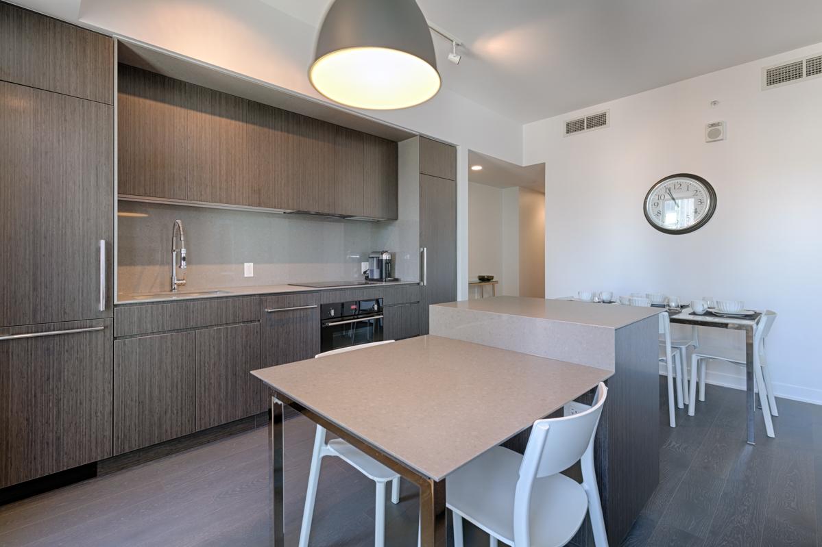 Kitchen at Tour des Canadiens Apartments, Centre, Montreal