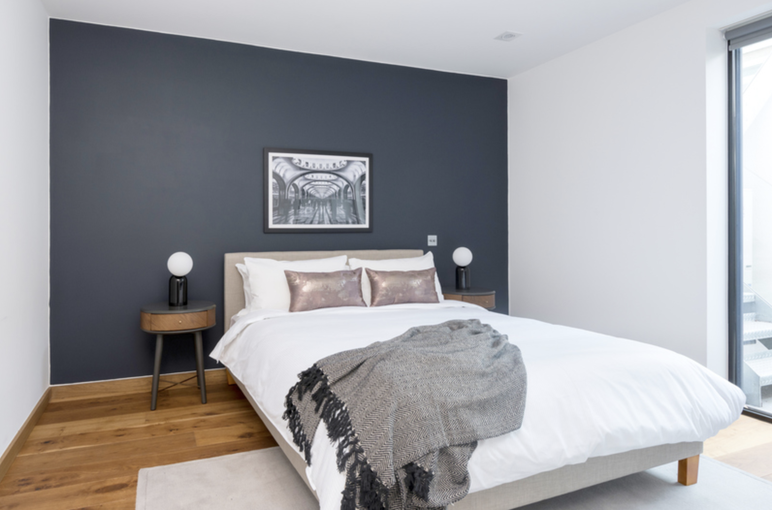 Cosy bed at Drum Court Apartments, Barnsbury, London