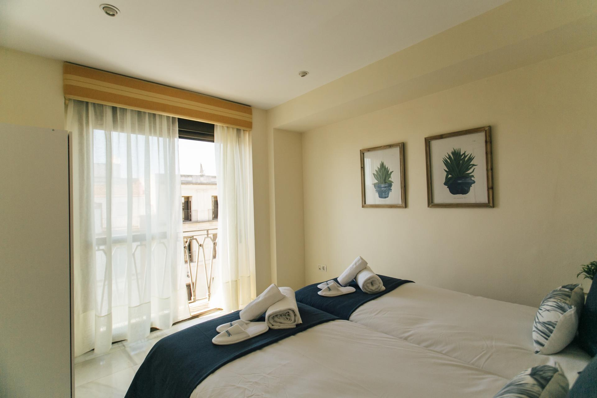 Bright bedroom at Constitucion Apartment, Centre, Seville