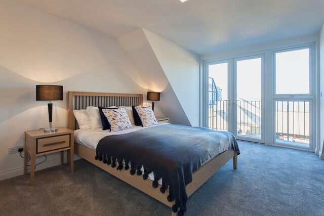 Spacious bedroom at Brixham Court Apartments, Centre, Staines