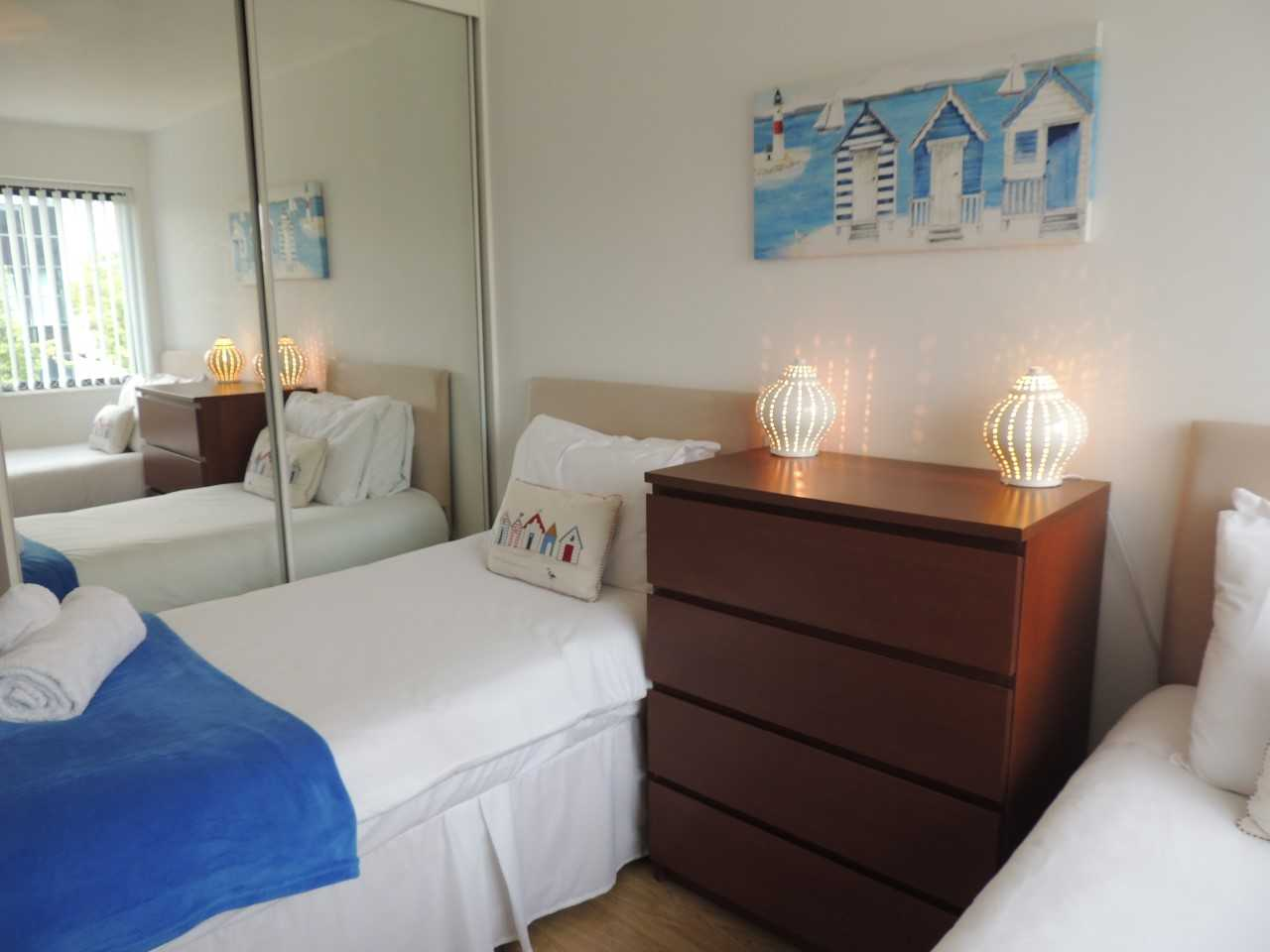 Twin beds at South Row Apartments