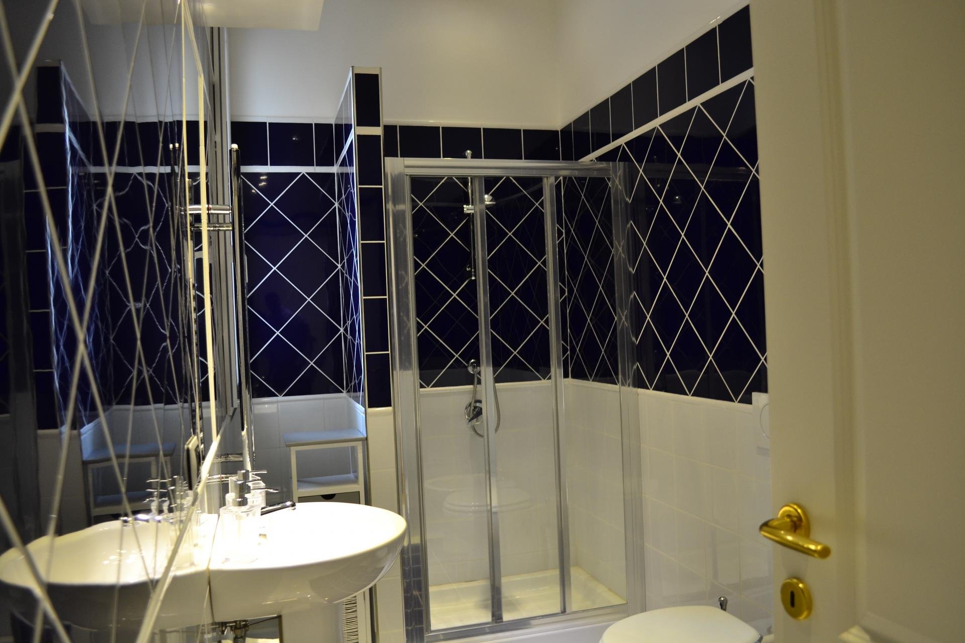Shower at Angelico Grand Apartment, Prati, Rome