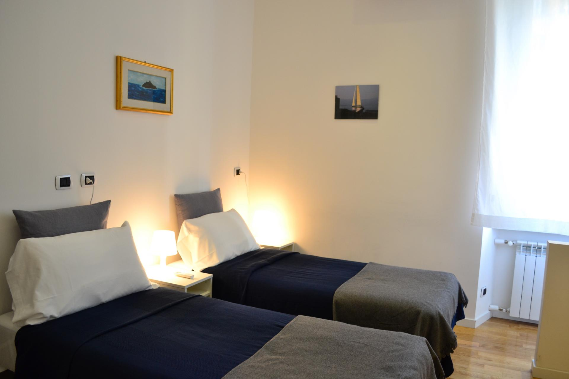 Twin beds at Angelico Grand Apartment, Prati, Rome