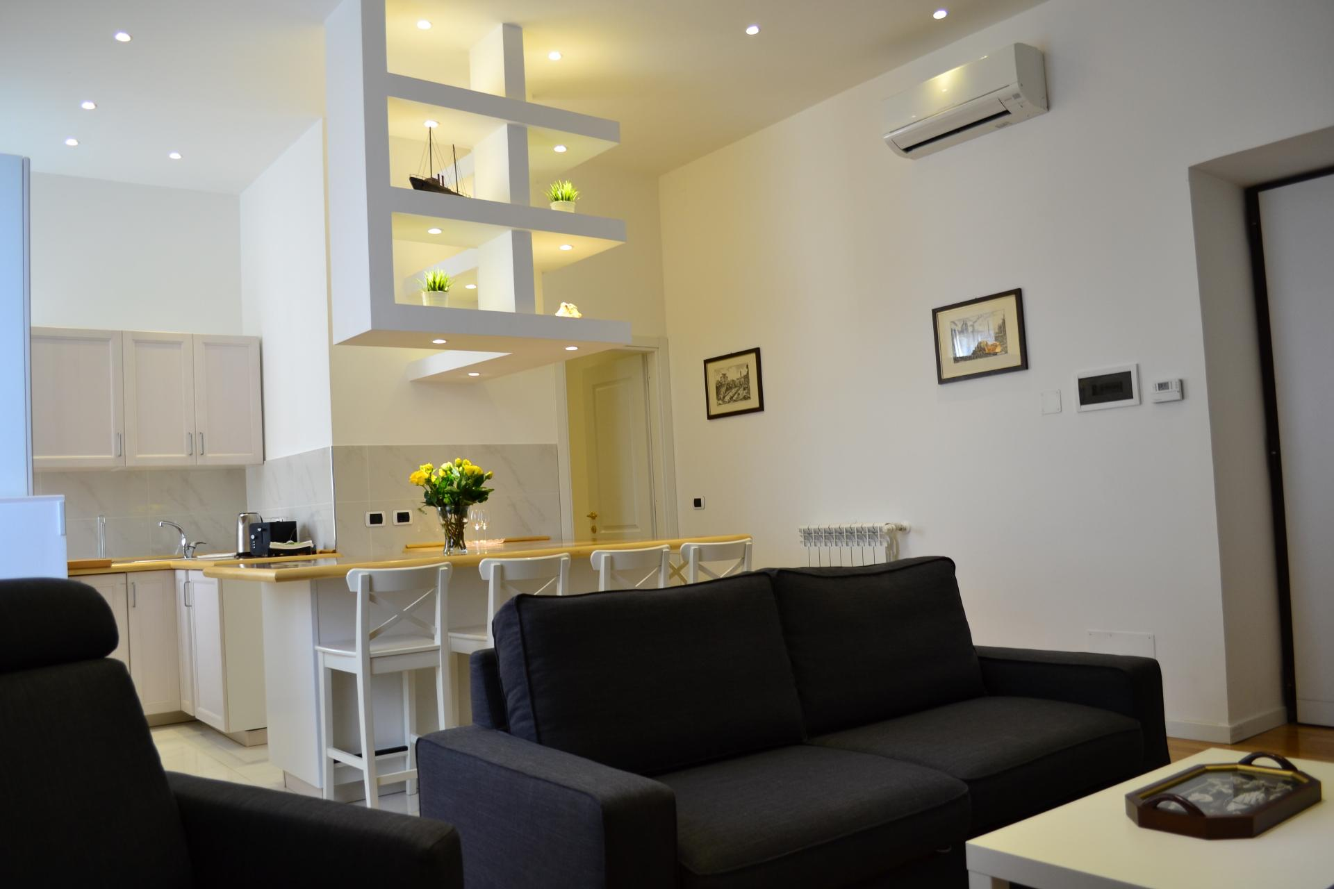 Seating at Angelico Grand Apartment, Prati, Rome