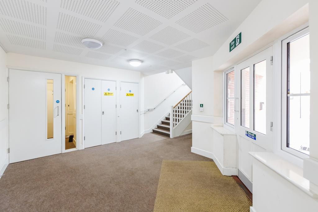 Communal hallway at Woodbridge Road Apartment, Centre, Guildford