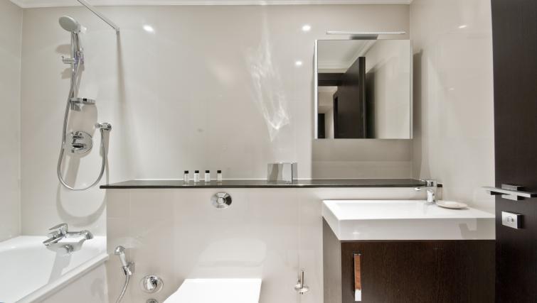 Bathroom in studio at 130 Queens Gate Apartments