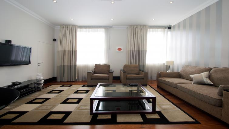 Spacious living area at 130 Queens Gate Apartments