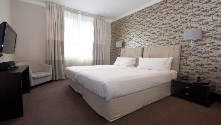 Deluxe bedroom at 130 Queens Gate Apartments