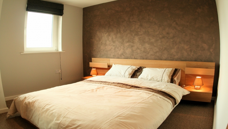 Cosy bedroom at Ebutler Grand Central Apartments