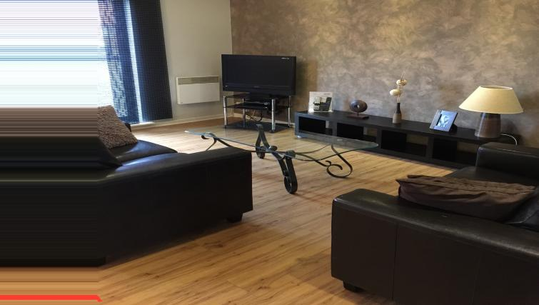 Living room at Ebutler Grand Central Apartments