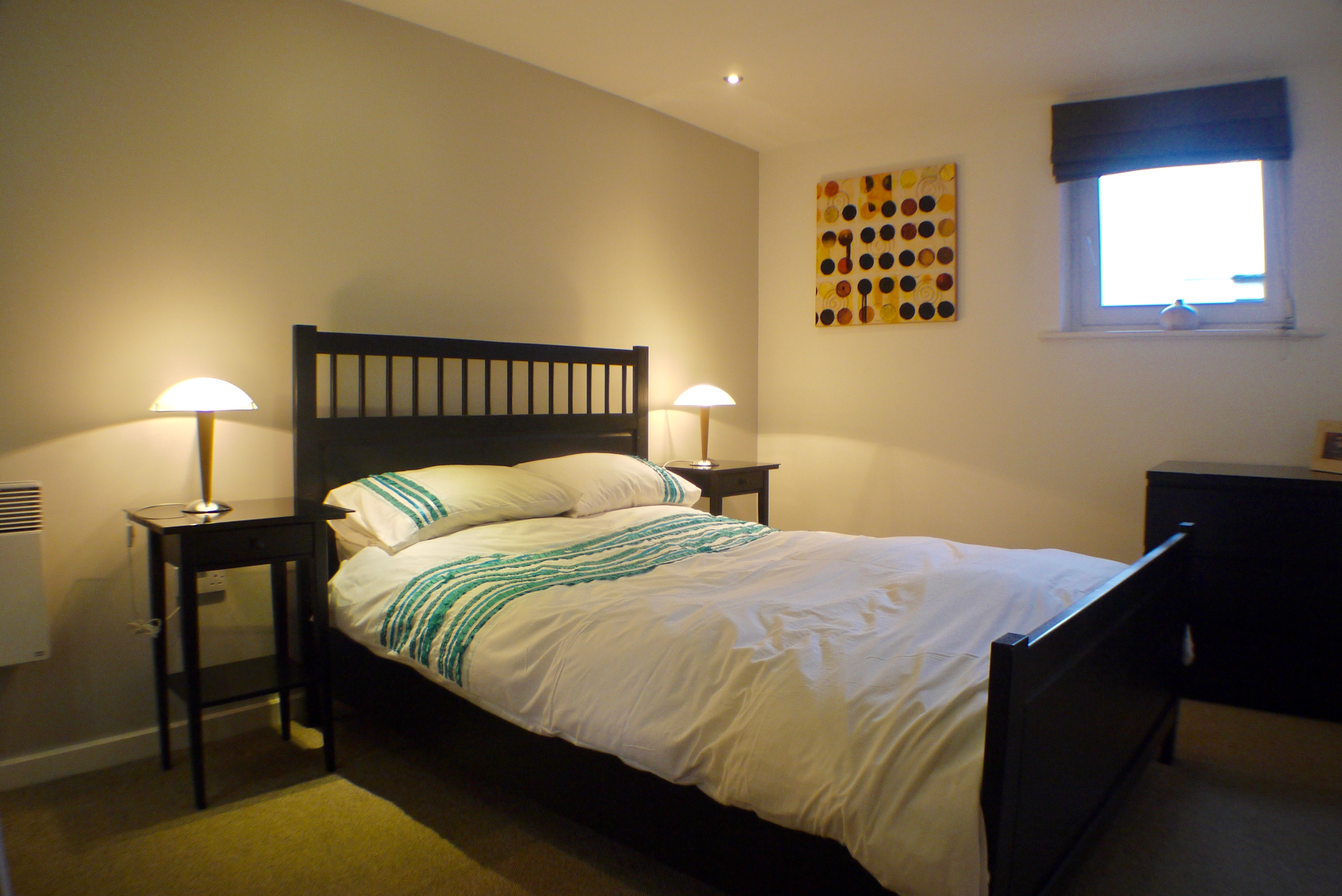 Double bed at Ebutler Grand Central Apartments