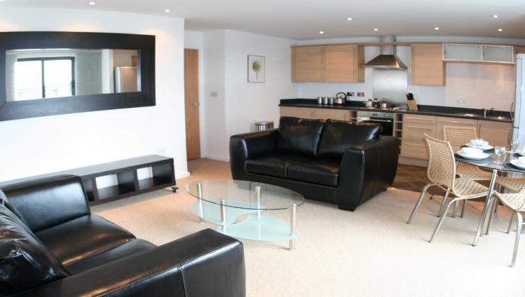 Spacious living area a Ebutler Grand Central Apartments