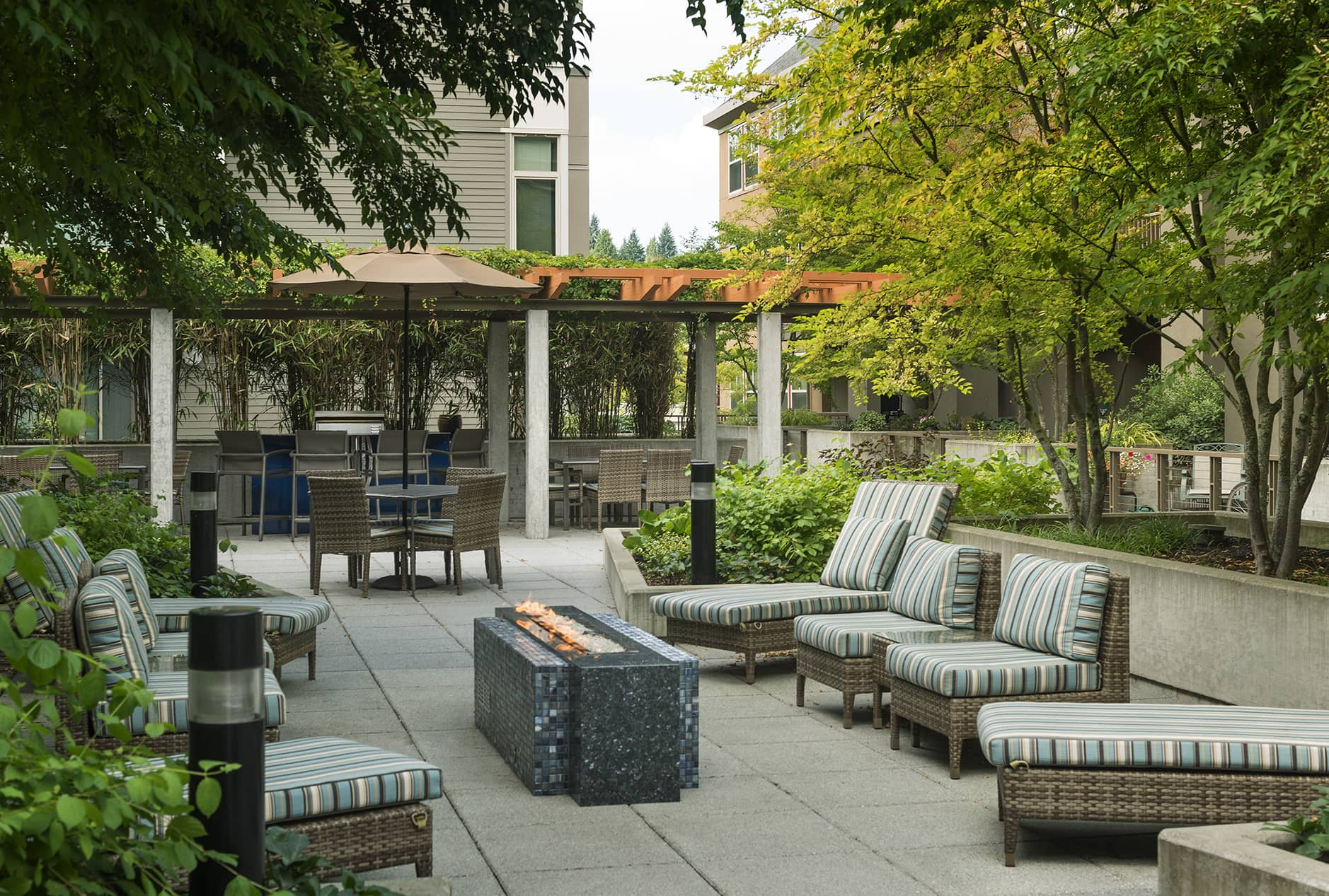 Outdoor Lounge and Fire Pit at Island Square Apartment