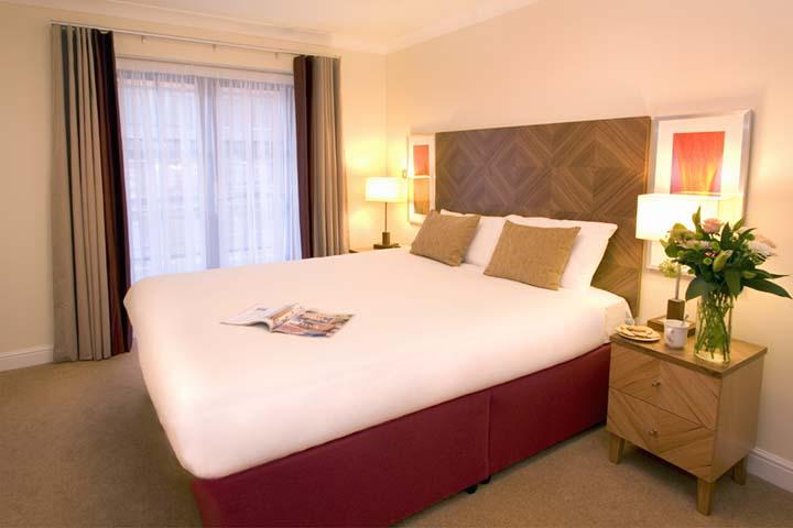 Large bedroom at Premier Suites Bristol Redcliffe Apartments