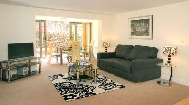 Pristine living area in Cotham Lawn Apartments