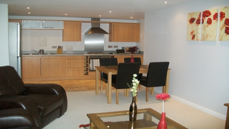 Contemporary living area in Tickabox Grand Central Apartments