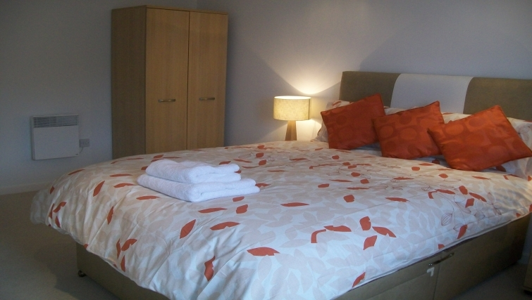 Comfortable bedroom in Tickabox Grand Central Apartments