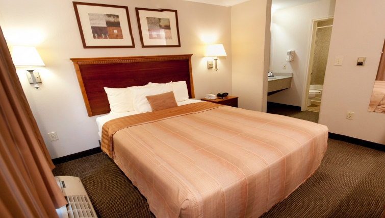 Bedroom in Candlewood Suites Dallas Market Centre