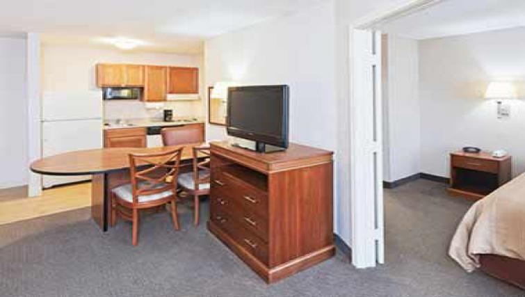 Compact dining area in Candlewood Suites Dallas Market Centre