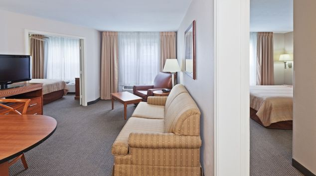 Living area in Candlewood Suites Dallas Market Centre