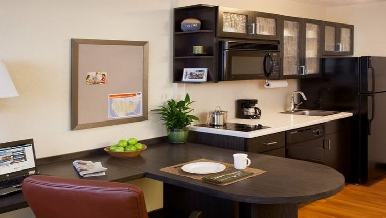 Compact kitchen in Candlewood Suites Houston by the Galleria