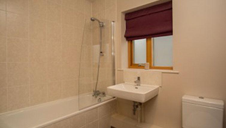 Bath and shower at Hercules Apartments