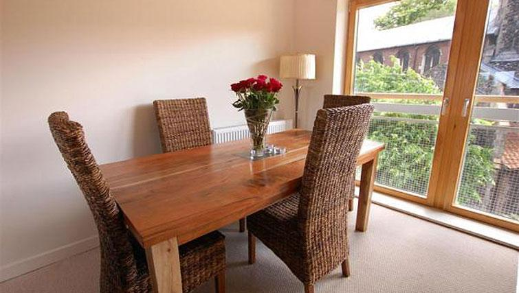 Bright dining area in Hercules Apartments