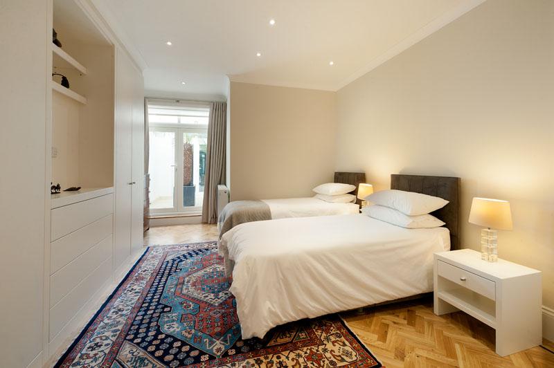 Beds at Cornwall Gardens Apartment, Kensington, London