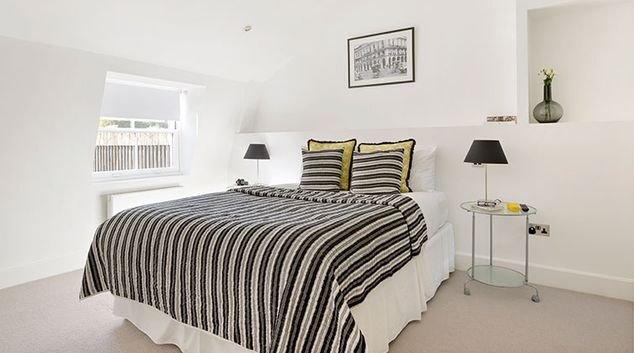 Bright bedroom at Nevern Place Aparthotel
