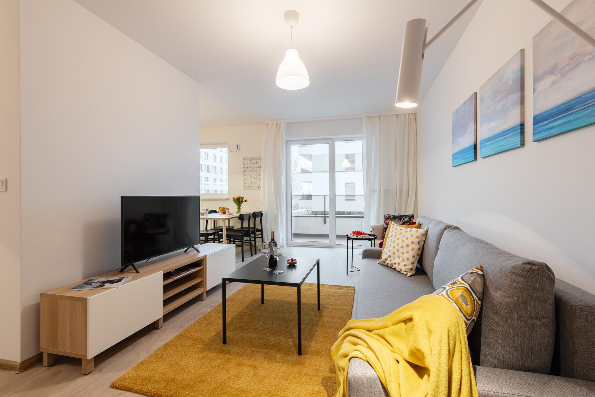 Living area at Cybernetyki Apartments, Sluzewiec, Warsaw