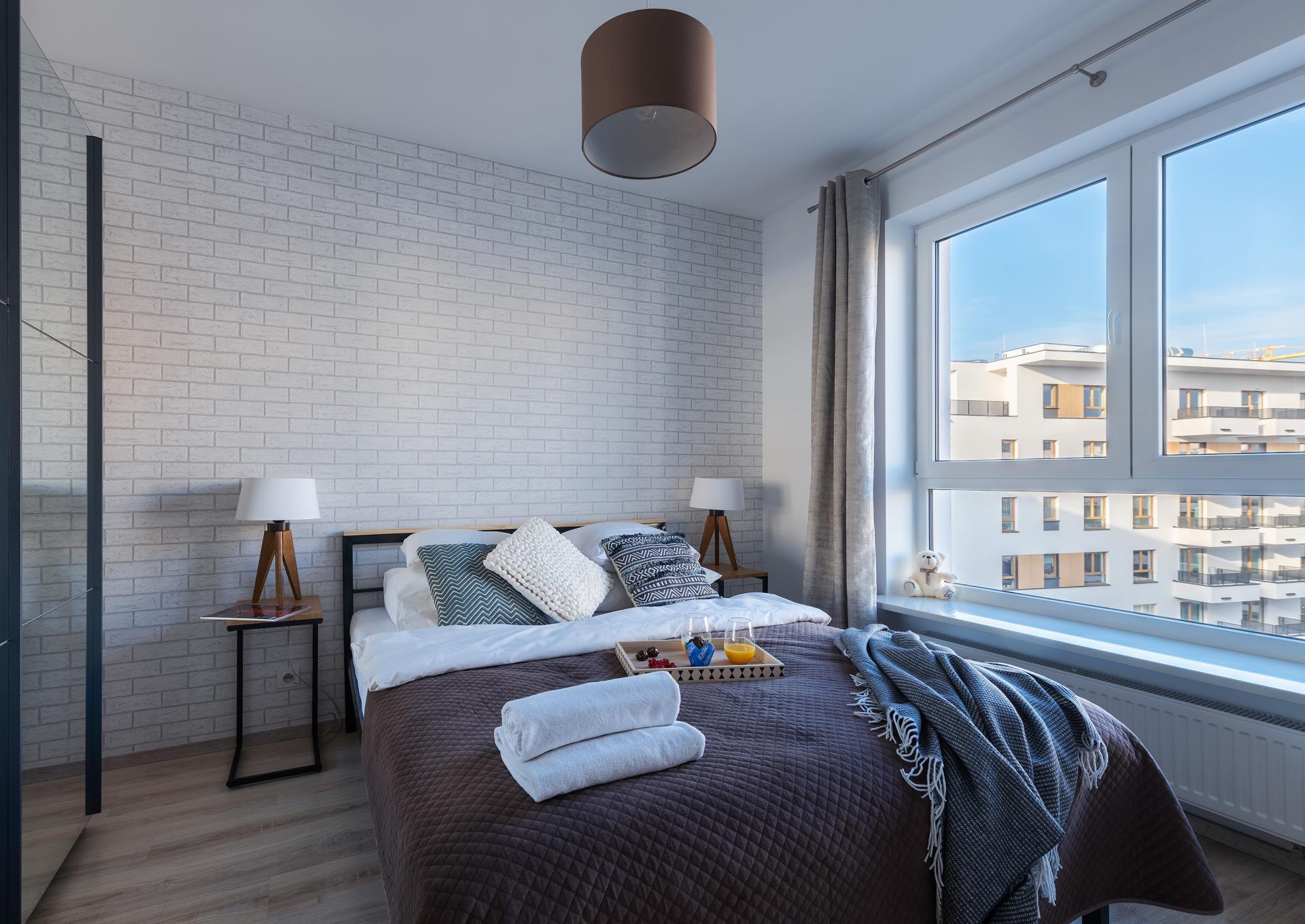 Bright bedroom at Cybernetyki Apartments, Sluzewiec, Warsaw