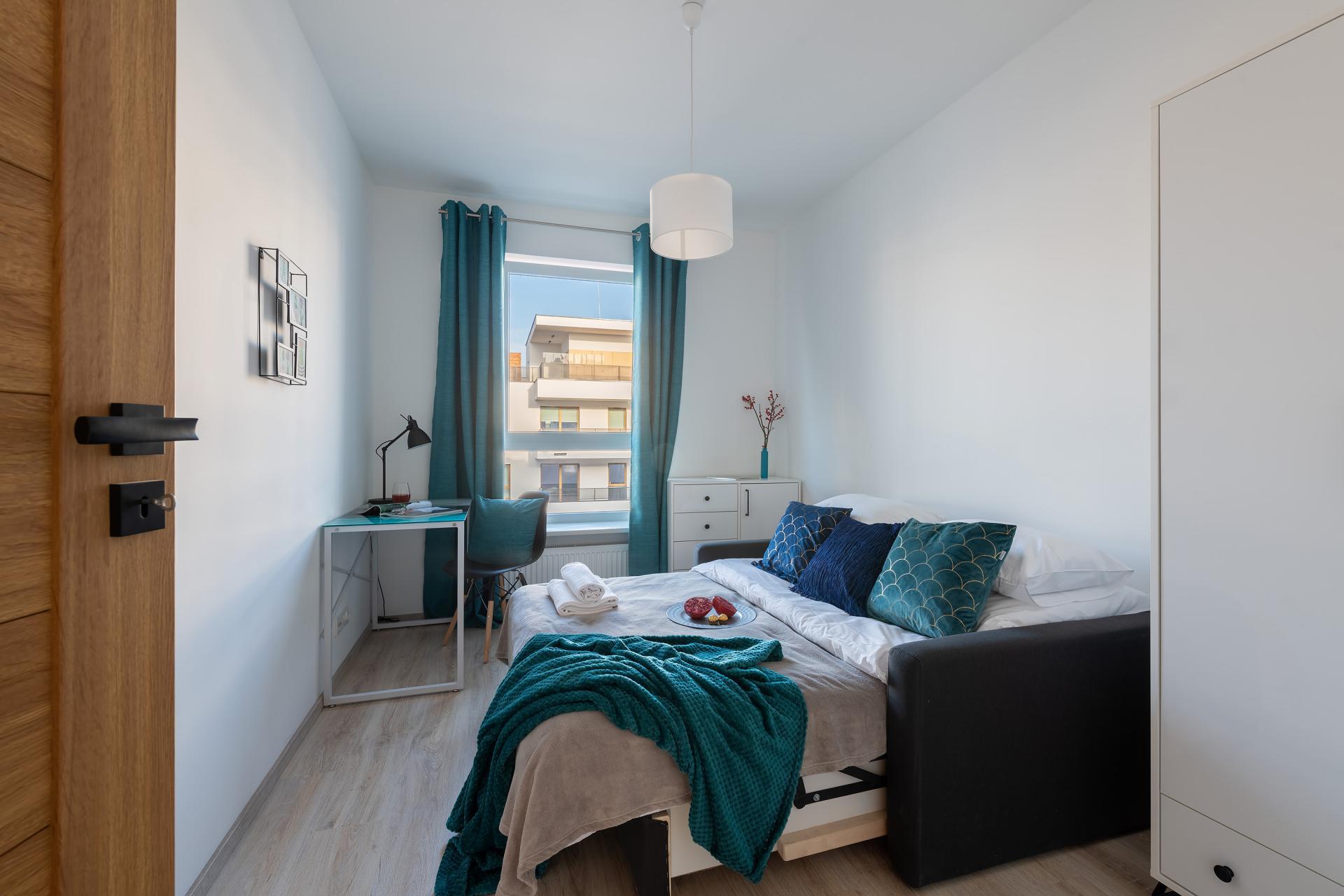 Sofa bed at Cybernetyki Apartments, Sluzewiec, Warsaw