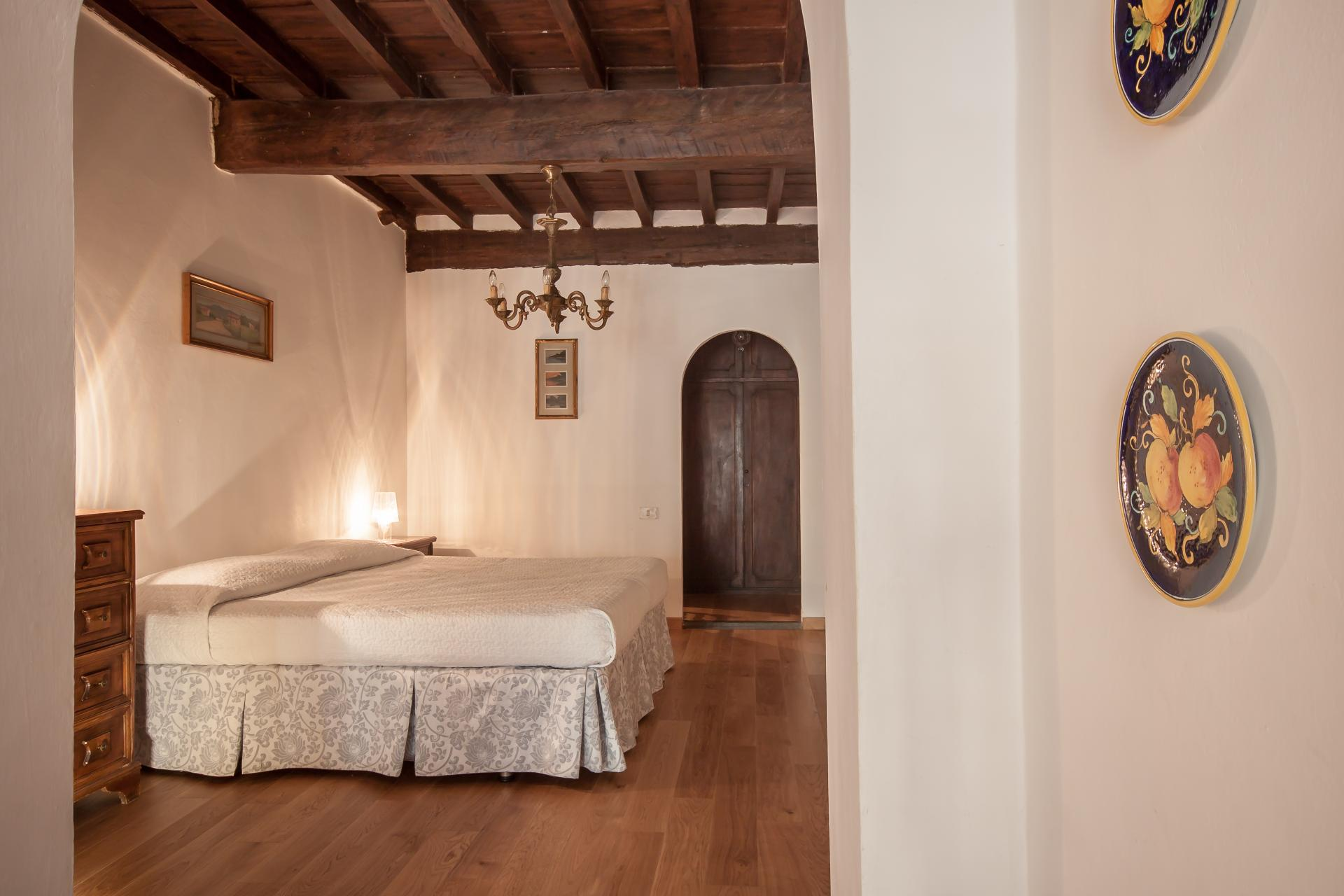 Bed at Borgo Ognissanti Apartment, Centre, Florence