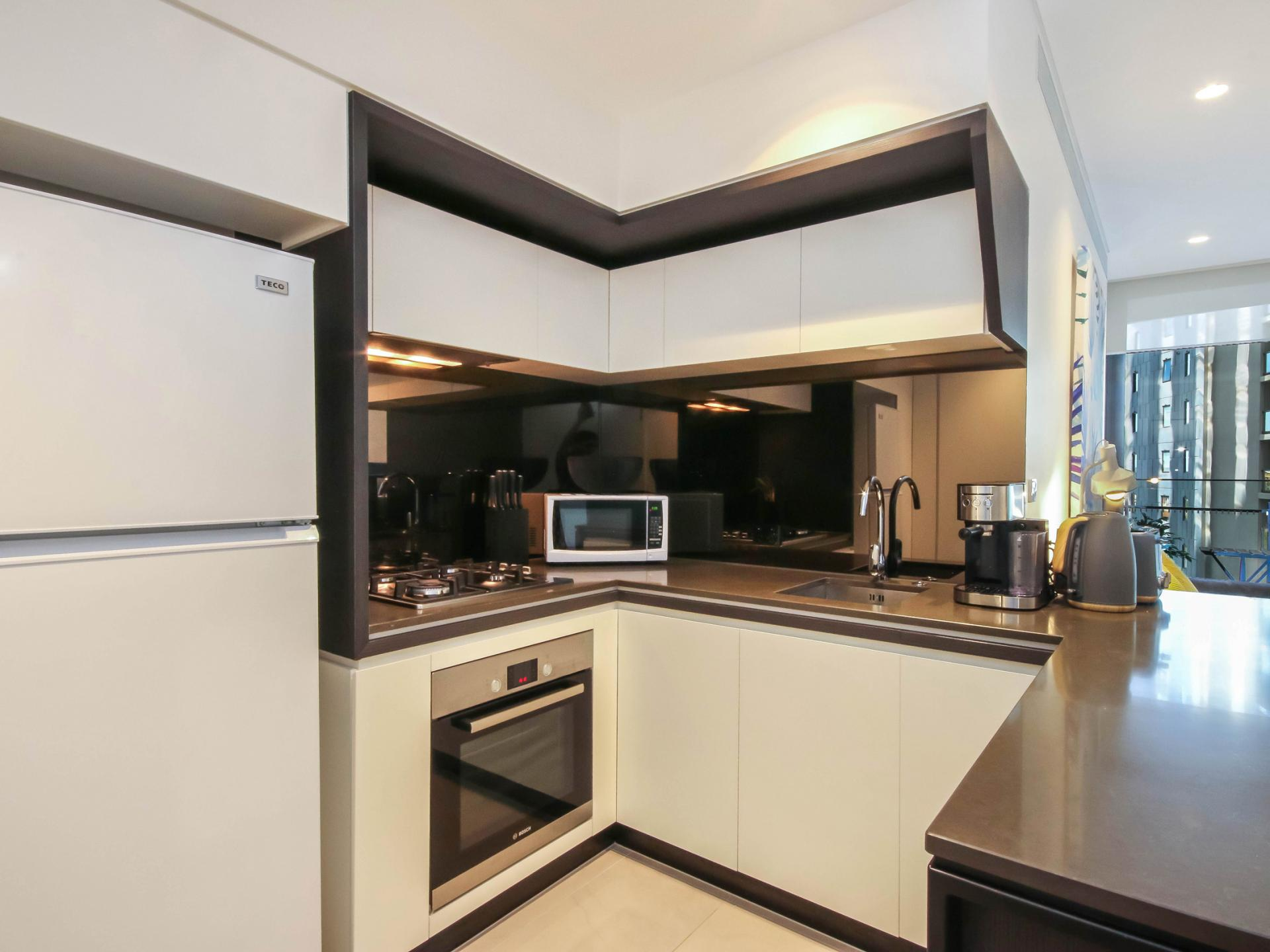 Modern kitchen at The Mary Street Apartment, Frog's Hollow, Brisbane