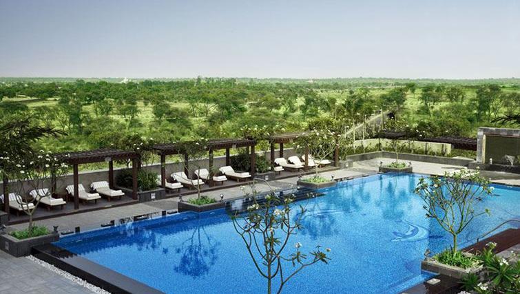 Swimming pool at The Leela Ambience Gurgaon Apartments