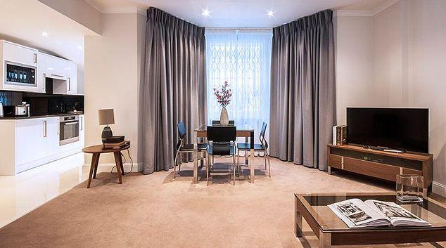 Pristine living area in Manson Place Apartments