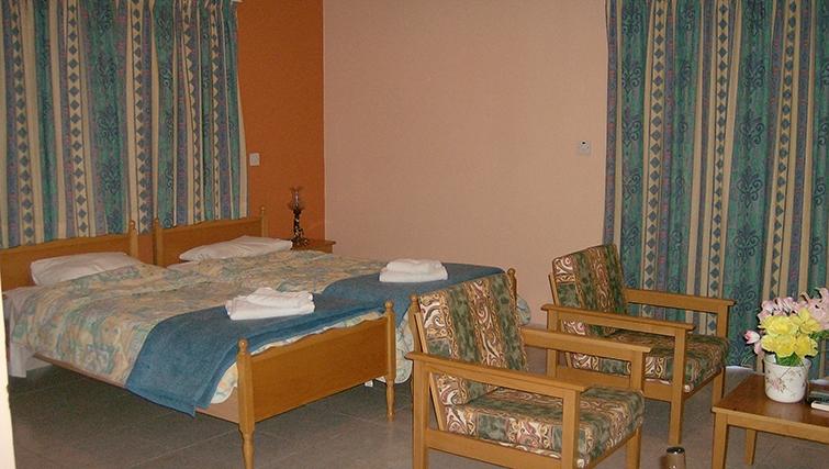 Twin bedroom at Rantzo Holiday Apartments