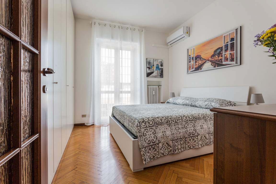 Bedroom at Bright Caneva Apartment, Bullona, Milan