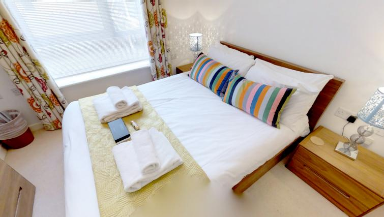 Bed at Kaleidoscope Apartments
