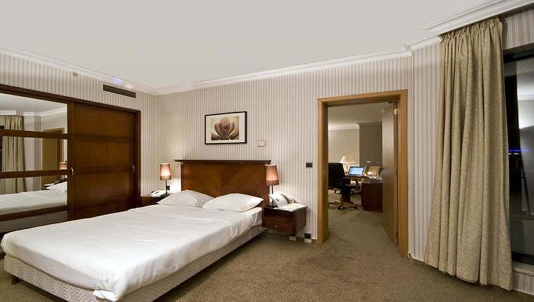 Bed at B-aparthotel Ambiorix