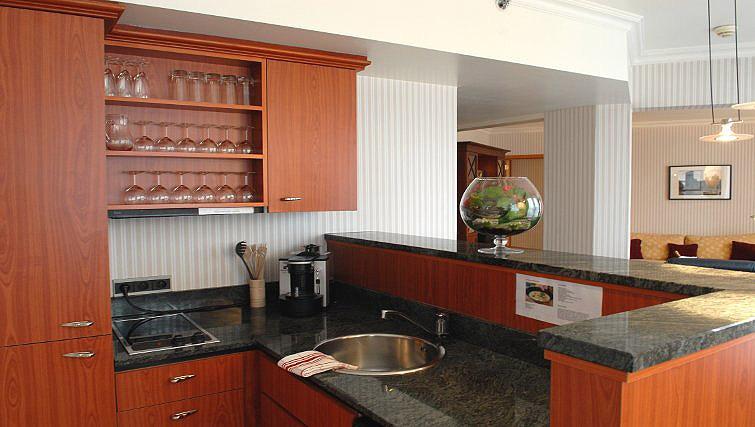 Modern kitchen in B-aparthotel Ambiorix