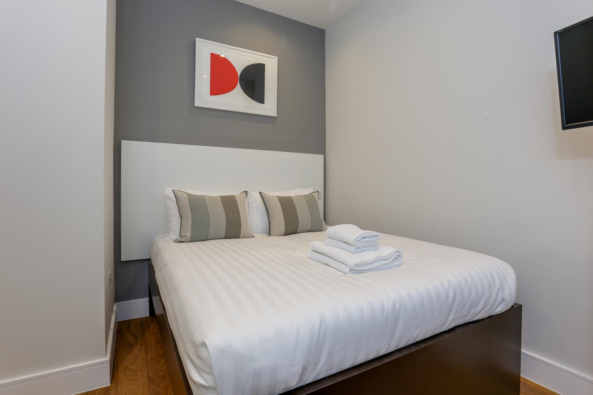 Cosy bed at Queensborough Terrace, Bayswater, London