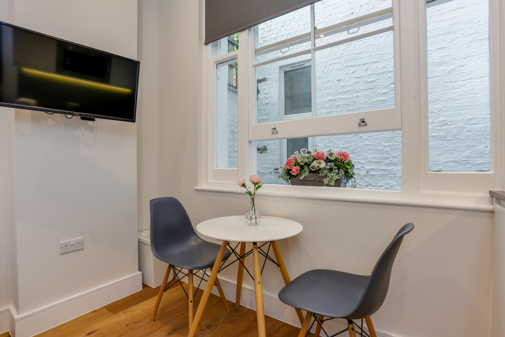 Dining table at Queensborough Terrace, Bayswater, London