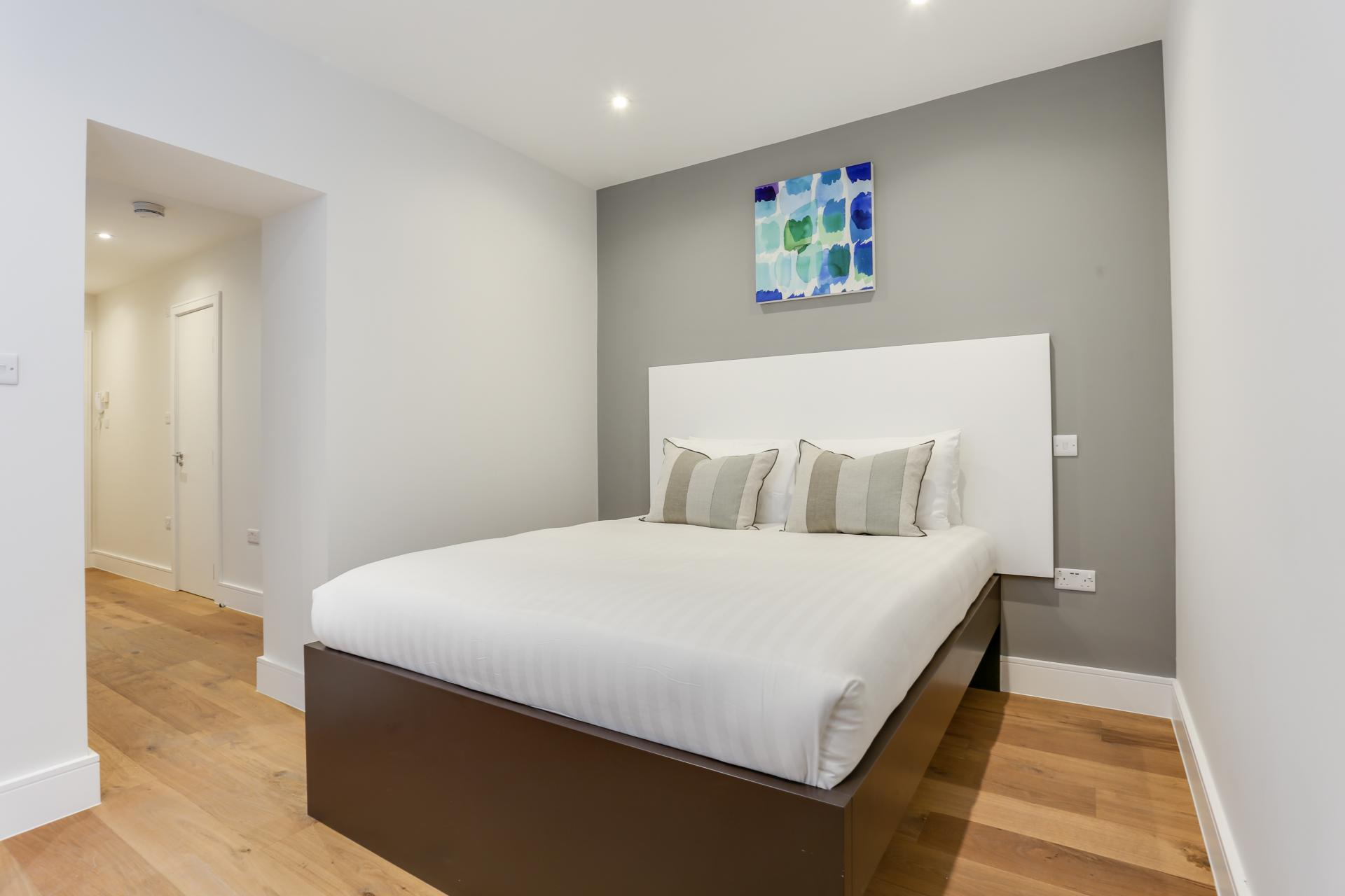Double bed at Queensborough Terrace, Bayswater, London