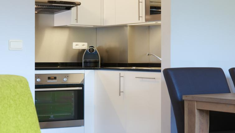 Equipped kitchen at Thon Residence Parnasse
