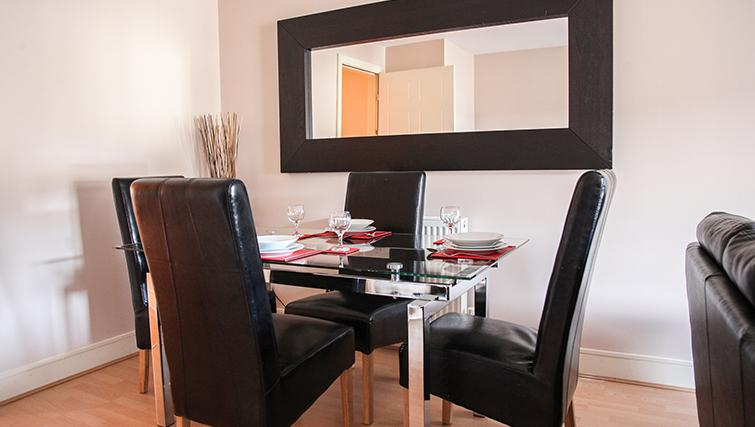 Modern dining area at Playhouse Apartments